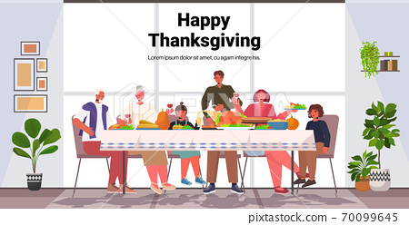 multi generation family celebrating happy thanksgiving day people sitting at table having traditional dinner 70099645