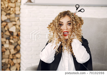 Woman in costume getting ready for halloween at home 70102098