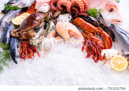Front view fresh seafood on ice background with copyspae 70103794