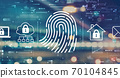 Fingerprint scanning theme with blurred city lights 70104845