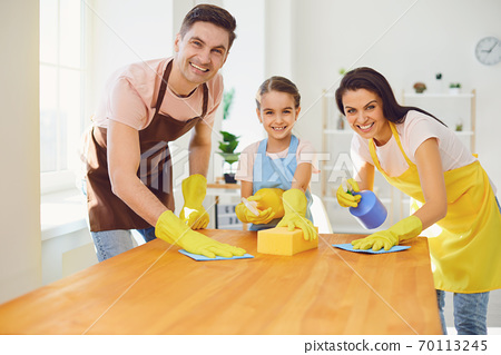 Happy family cleans the room in the house. 70113245