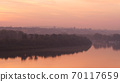 Danube River Bank Landscape with Trees Reflecting on Water at Sunrise in Timelapse 70117659