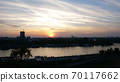 Dramatic Yellow and Orange Sunset Sky Cloudscape in Timelapse over Belgrade Serbia 70117662