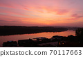 Landscape of Danube River Bank with Trees Reflecting on Water at Sunrise  70117663