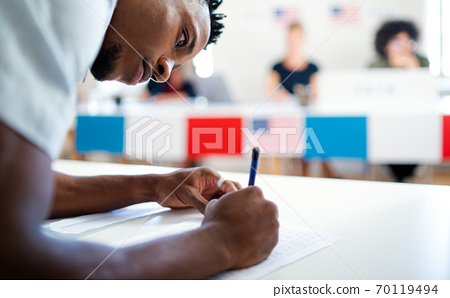 African-american man voter in polling place, usa elections concept. 70119494