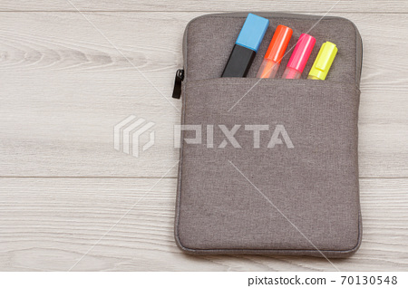 Bag-pencil case with color felt pens and marker on grey background 70130548