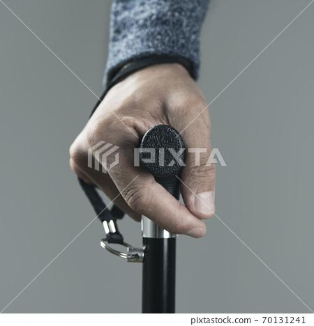 man using a walking stick 70131241