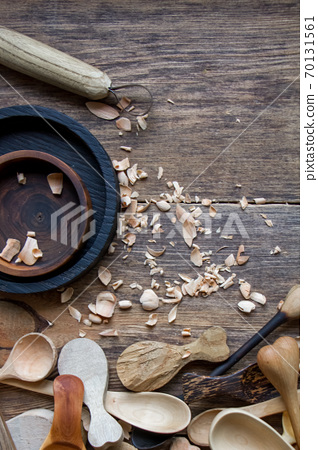 Handmade wooden utensils, top view lot of billets, spoons and plates on table, selective focus 70131561