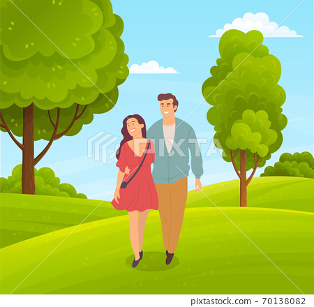 Couple of happy girl and guy walking in park or countryside people walk at nature hugging each other 70138082