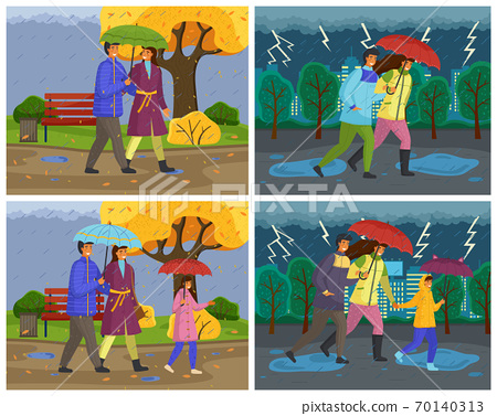 Family walking in the rain down the city street with umbrella and wearing raincoats in autumn season 70140313