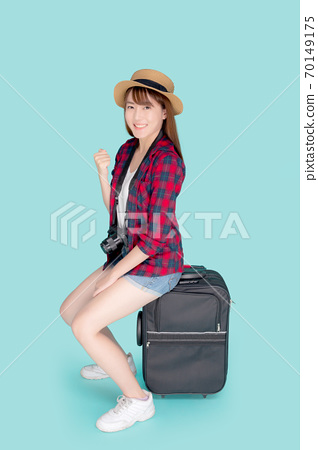 Beautiful young asian woman sitting on luggage smile and travel summer trip for abroad in vacation. 70149175