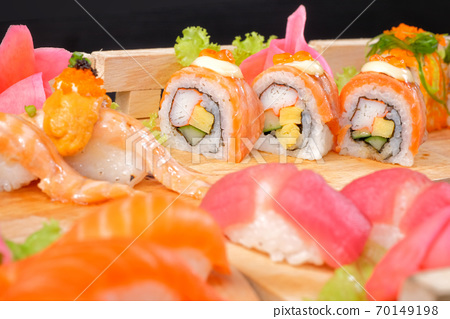 Japanese Cuisine - Sushi Roll on wood plate in black background 70149198