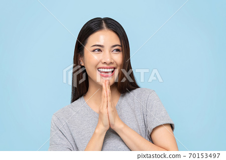 Smiling beautiful Asian woman doing Wai gesture 70153497