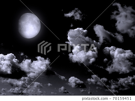 The moon in the night sky 70159451