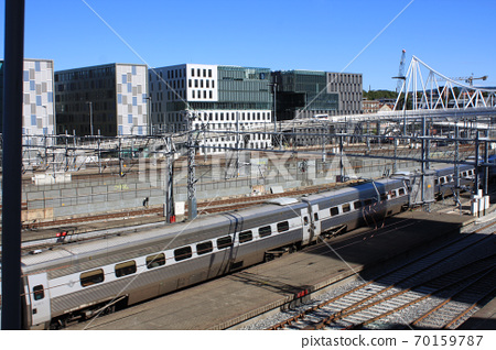 Oslo view with train station and modern buildings. They are some of the new buildings in the neighbourhood of Bjorvika, the station is the biggest of Norway. 70159787