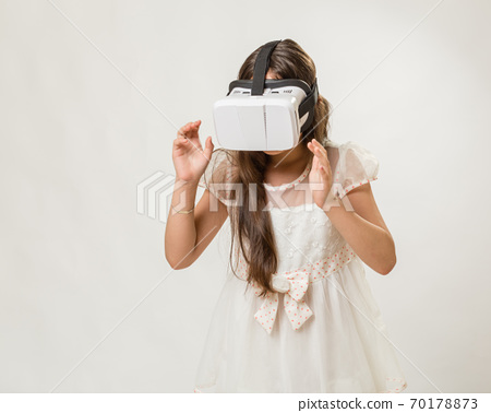 Young girl in VR goggles 70178873