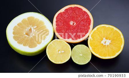 Citrus fruit. Cut orange, lemon, lime and grapefruit on dark background 70190933