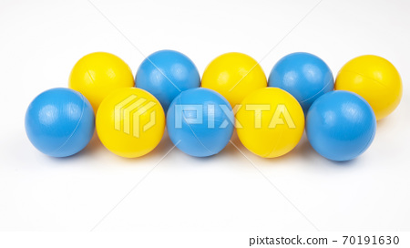 Colored plastic balls on white background. leisure and game items. round objects 70191630