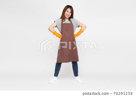 Asian woman standing and wearing orange rubber gloves isolated over white background. 70201259
