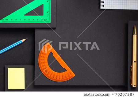 school accessories and office supplies at black background surface 70207287