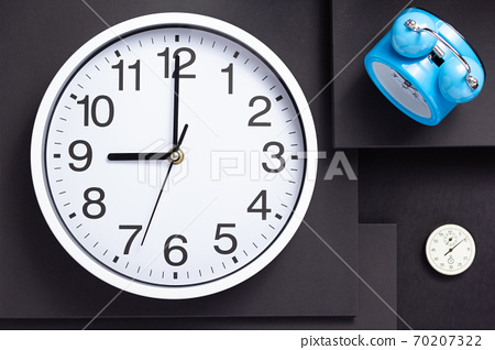 clock at black paper abstract background 70207322