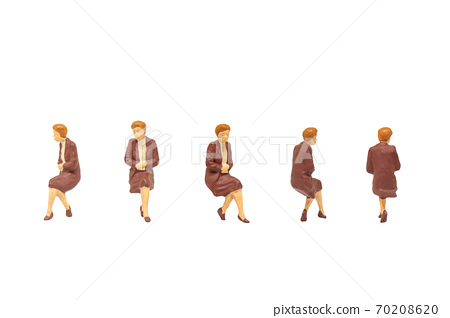 Miniature people as seated passenger isolated on white background. 70208620