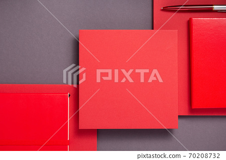 notebook and pen at abstract grey with red background 70208732