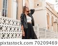 Pretty happy young woman model in elegant stylish 70209469