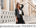 Trendy European young girl in an fashionable 70209470