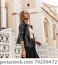 Cute European young girl with a beautiful smile in 70209472