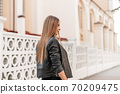 Stylish modern young woman with a long brown hair 70209475