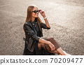 Trendy happy young hipster woman with a beautiful 70209477