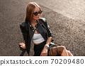 Pretty beautiful young woman in fashionable 70209480