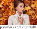 Happy chic pretty young woman with blue eyes with 70209484