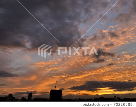 Summer dusk sky with clouds of various colors 70210389