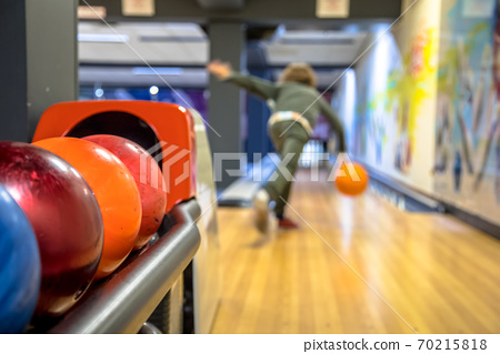 Child throwing bowling ball 70215818