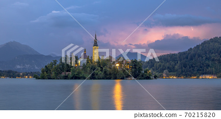 Lake bled with church under lightning sky 70215820