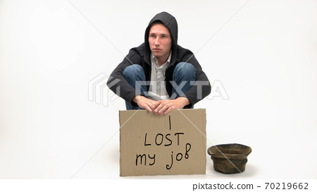 Young jobless man with cardboard sign. 70219662