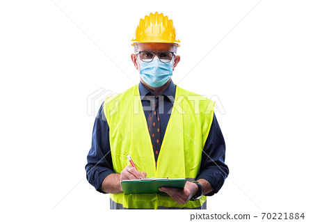 Engineer at work protects the face with the surgical mask. Construction industry. Covid-19 prevention. 70221884