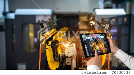 Engineer controls robotic arms by augmented reality industry technology 70230332