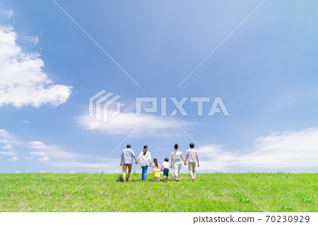 Three generations family, blue sky, walking 70230929