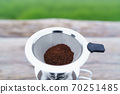 coffee powder in the coffee filter. 70251485