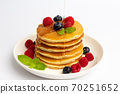 Delicious pancakes with raspberry and blueberry on White background 70251652