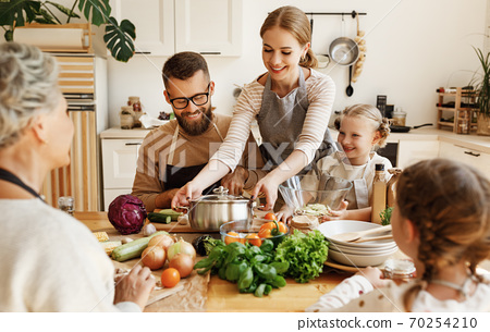 Happy family preparing healthy lunch together. 70254210