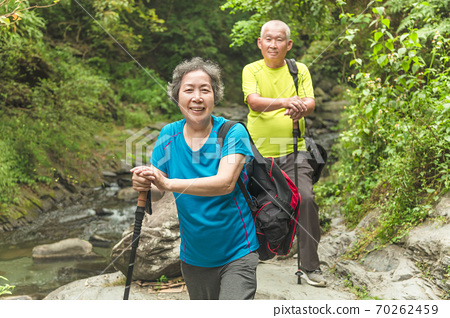 Happy Asian senior couple hiking in nature park 70262459