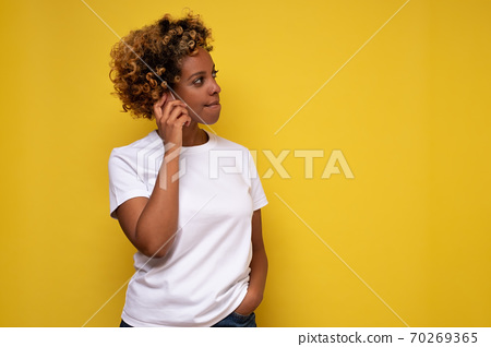 Portrait Of african american woman talking on phone listening to news seriously. 70269365