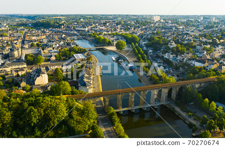 Aerial view of Laval with railway bridge across Mayenne River, France 70270674