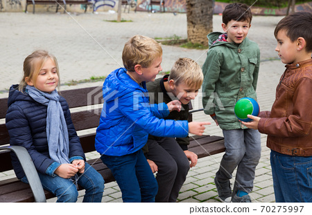 Kids playing with ball on bench 70275997
