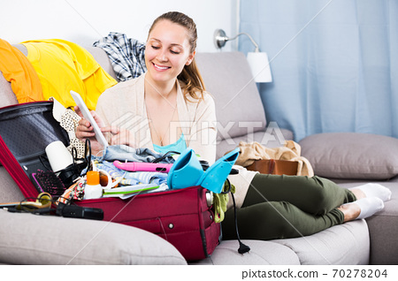 Woman getting ready for holidays 70278204