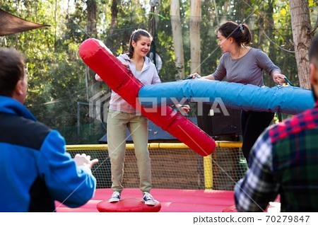 Female friends fighting by big stuffed beams 70279847